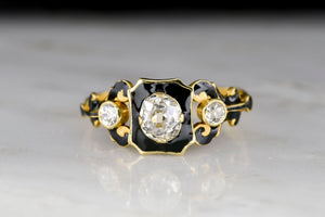 Early Victorian (London, 1844) 18K Gold and Black Enamel Ring with an Old Mine Cut Diamond Center
