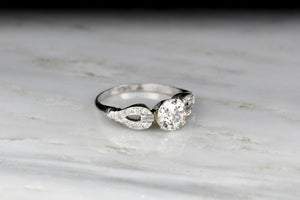 "Late Art / Mid Century Platinum Engagement Ring with ""Buckle-and-Clasp"" Shoulders"