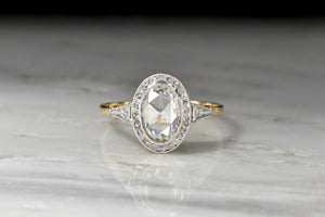 Stunning Belle Époque Engagement Ring with a GIA Oval Rose Cut Diamond Center