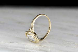 Vintage GIA Oval Rose Cut Diamond Ring with a Twisted Rope Halo