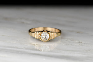 Late Victorian Buttercup Gold Ring with an Old Mine Cut Diamond