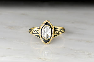 Victorian (1883) Mourning Ring with an Oval Rose Cut Diamond Center
