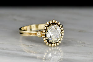 Unique Art Deco or Mid Century Gold Sunburst Ring with an Old Mine Cut Diamond Center