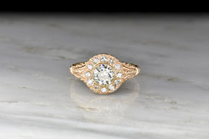 Late Victorian Halo Ring with an Old European Cut Diamond Center