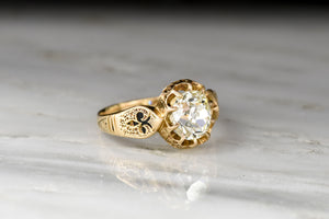 Victorian 18K Oval Ten-Prong Engagement Ring with a 1.32 Carat Old Mine Cushion Cut Diamond