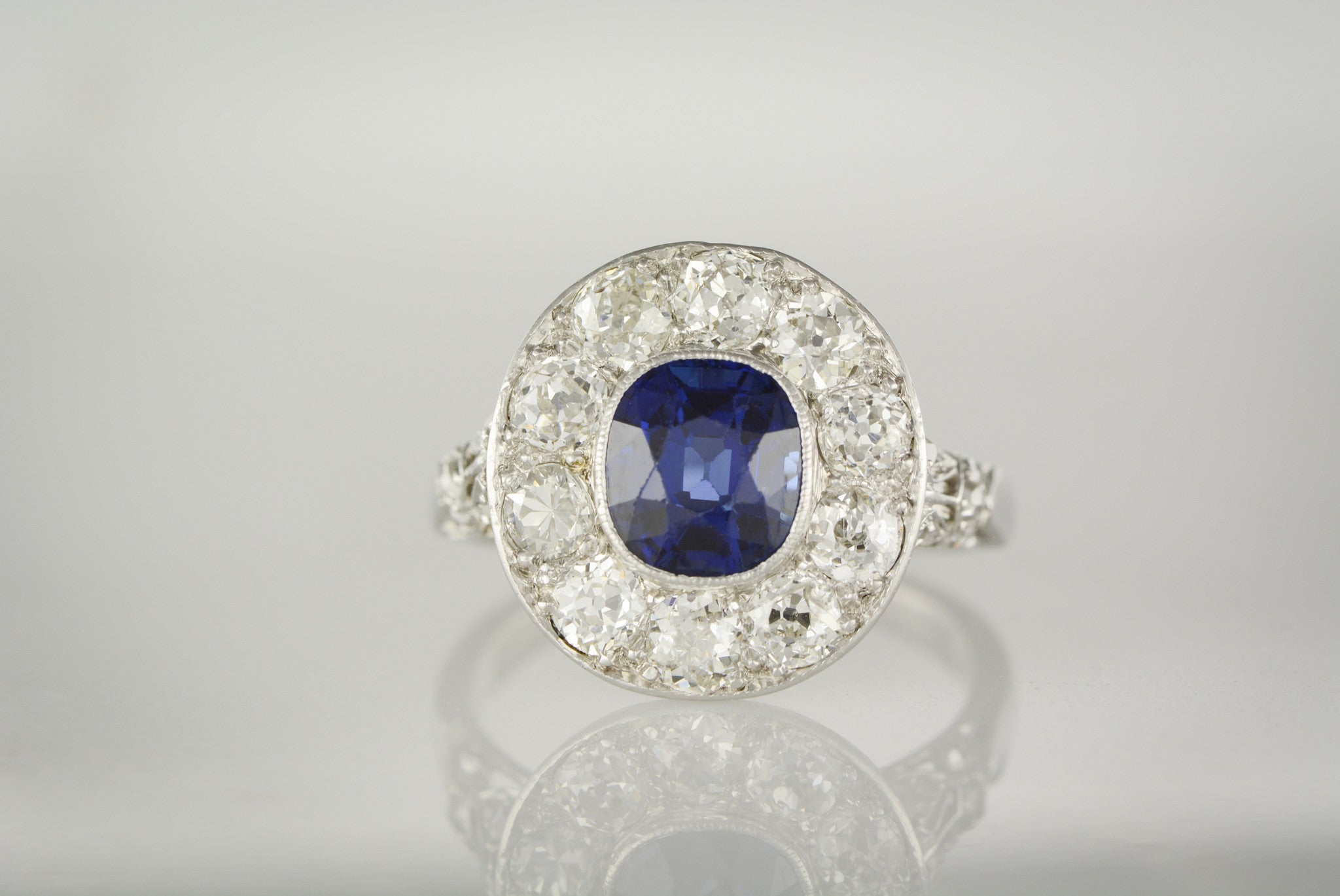 Art Deco Anniversary Or Engagement Ring 1 80 Carat Oval Cushion Cut Natural Sapphire With 2 00 Ctw Old Mine And Antique Rose Cut Diamond Halo Accents