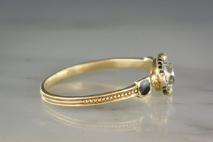 Early Old European Cut Diamond in Yellow Gold with Black Enamel