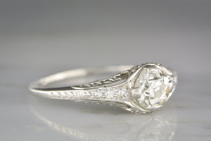.75 Carat Old European Cut Diamond in a c. 1910s Edwardian / Art Deco Platinum Engagement Ring with Diamond Accents and Floral Engraving / Filigree