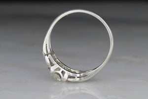 Art Deco Engagement Ring With Subtle Chain and Link Design