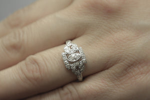 1920s Art Deco Platinum Engagement or Anniversary Cocktail Ring with Marquise Cut Diamond Center