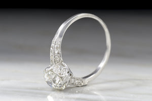 Antique Edwardian Engagement Ring with 1.35 Carat Old European Cut Diamond Center in a Hand-Engraved Solitaire Mount