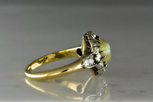 Antique Georgian/Victorian Engagement or Anniversary ring with Cabochon Cut Cat's Eye (Chrysoberyl) Center and Rose Cut Diamond Cluster Halo