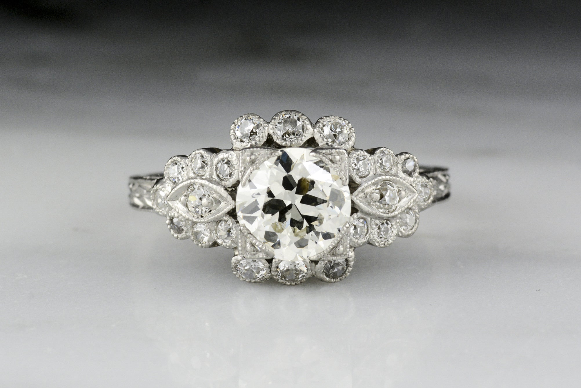side cut ring accented radiant platinum center michael stones bridal barin diamond two emerald stone w