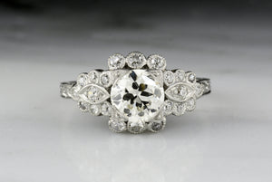 Early Art Deco Old European Cut Diamond Engagement Ring with Geometric Detailings