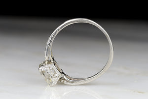 Late Edwardian Engagement Ring with a 1.68 Carat Old Step Cut Diamond Center
