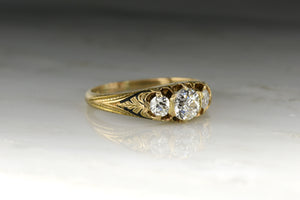 Antique Victorian Engagement Ring: Gold and Black Enamel Three-Stone Past, Present, Future Engagement Ring with Old Mine Cut Diamond Center