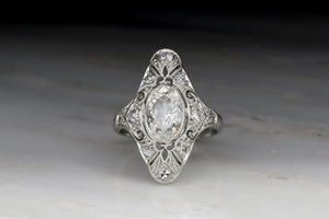 Antique Edwardian, Art Deco Women's Diamond Ring with Ornate Open Filigree and Oval Cut Diamond Center