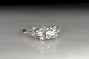 Late Art Deco Engagement Ring with a Geometric Baguette Cut Shoulder Design