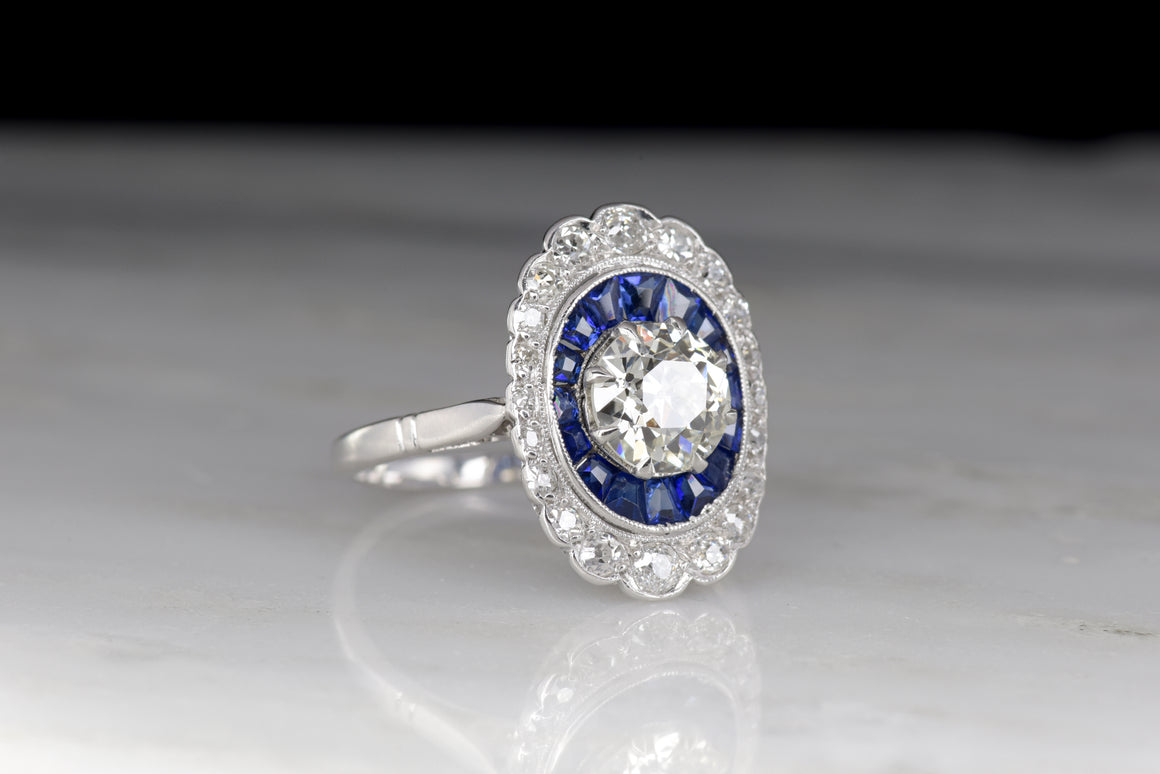 French Art Deco Cocktail Ring with a GIA Certified 1.07 Carat Old European Cut Diamond and Calibré Cut Sapphires