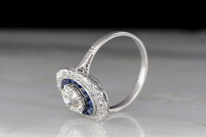 French Art Deco Cocktail Ring with GIA 1.07 Carat Old European Cut Diamond and Calibré Cut Sapphires