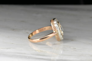 Victorian Rose Gold and Silver Ring with a GIA 1.01 Carat Oval Rose Cut Diamond