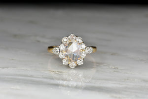 Victorian Gold and Platinum Old Miner Cluster Ring with an Oval Rose Cut Diamond Center