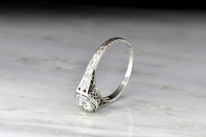 c. 1910s Edwardian Ring with a Hexagonal Bezel-Set Transitional Cut Diamond Center