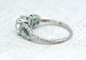 2.27 ctw Edwardian / Art Deco Platinum Engagement Ring with 1.82ct Old European Cut Diamond and .45 Single Cut Diamonds and Natural Emerald Accents
