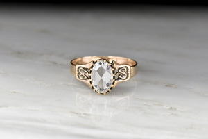 Victorian Multi-Prong Engagement Ring with a GIA Oval Rose Cut Diamond Center