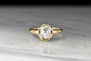 Late Victorian Gold Solitaire Engagement Ring with a 1.03 Carat Oval Rose Cut Diamond