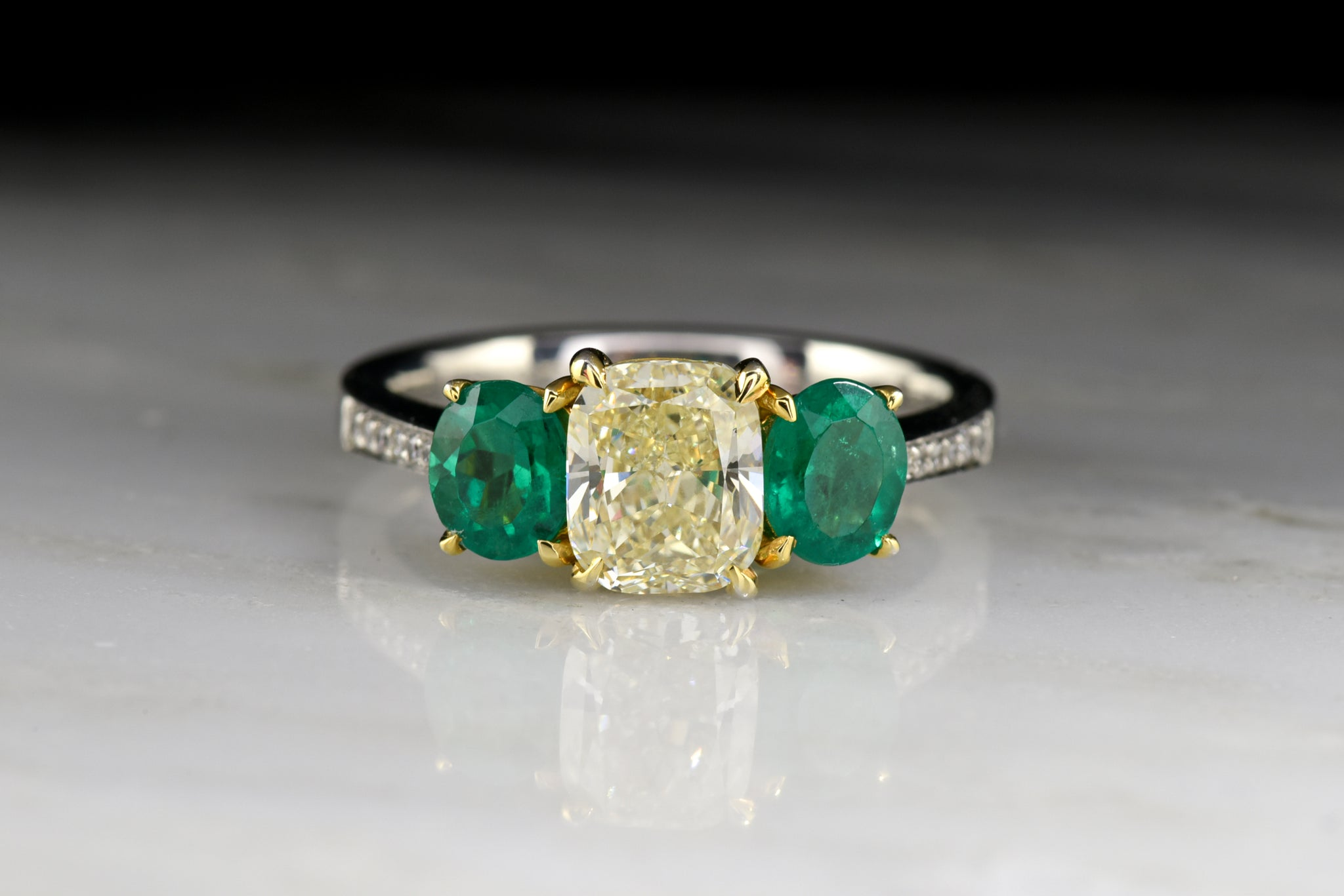 Vintage Henri Daussi Engagement Ring With 1 20 Carat Radiant Cushion Cut Light Yellow Diamond And Oval Cut Emeralds