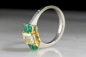 "Vintage ""Henri Daussi"" Engagement Ring with 1.20 Carat Radiant Cushion Cut Light Yellow Diamond and Oval Cut Emeralds"