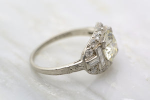 2.25ctw Edwardian Platinum Engagement / Cocktail Ring: 1.5ct Old European Cut Diamond and .75ct Emerald and Single Cut Diamonds