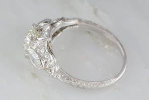 2.15ctw Platinum Edwardian Engagement Ring with a 1.42ct Old Mine Cushion Cut Diamond and .75ctw Marquise and Single Cut Diamond Accents