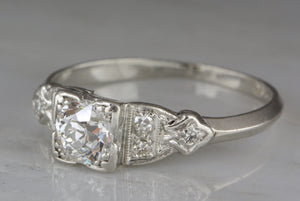 .77ctw Edwardian / Art Deco .65ct Old European Cut Diamond and Platinum Engagement Ring with .12ctw Diamond Accents