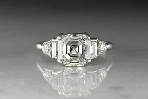 GIA Certified 2.25 Carat Asscher Cut Diamond in an Antique Platinum and Diamond Art Deco Engagement Ring