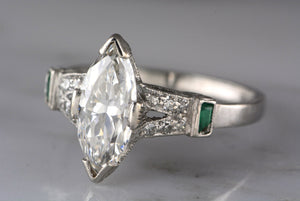 1.60ctw Edwardian / Art Deco Platinum Engagement Ring with 1.35ct Marquise Cut Diamond with Emerald and Single Cut Accents