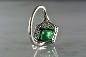Antique 1.40 Carat Asscher Cut Emerald in an Edwardian / Art Deco Engagement or Anniversary Ring with Single Cut Diamonds