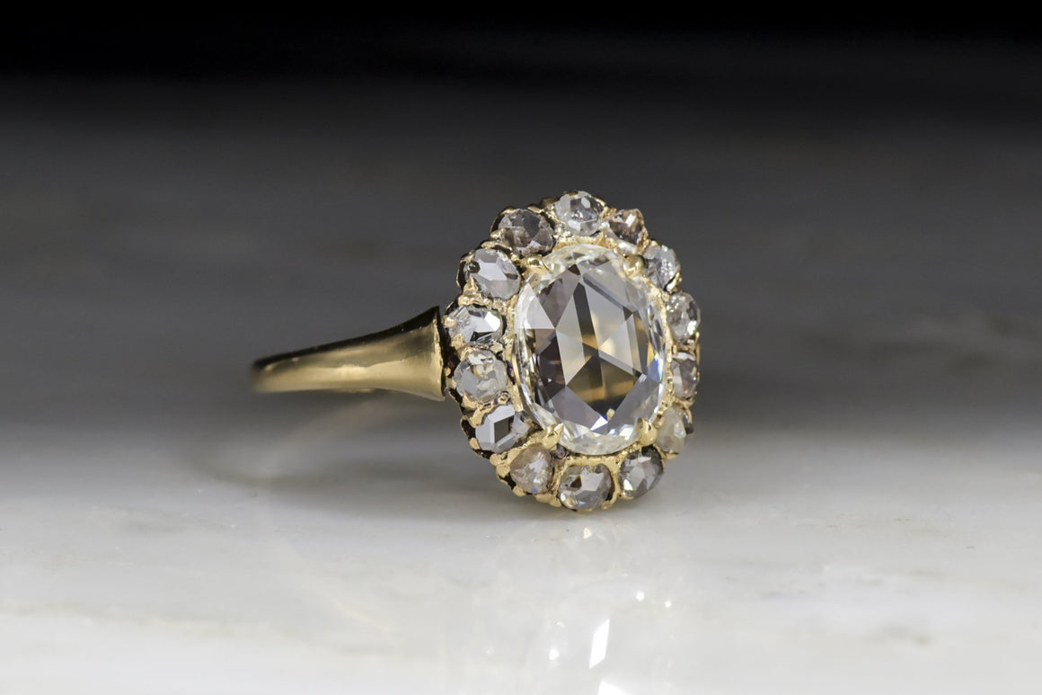 Antique Victorian Cluster Engagement Ring with Oval Rose Cut Diamond Center and Diamond Halo in 18K Rose-Yellow Gold