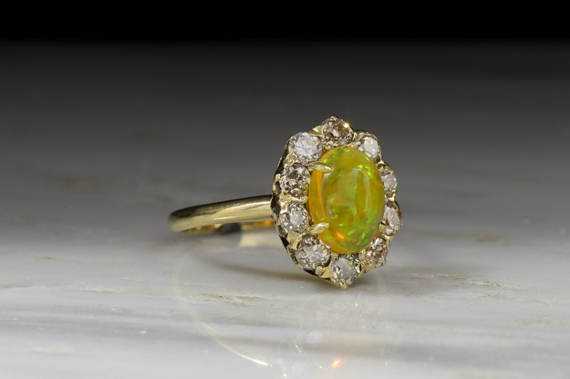 Antique Victorian Women's Engagement, Anniversary, or Fashion Ring with a Stunning Jelly Opal Center and Cape Diamond Halo