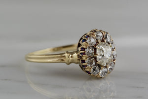 1.20ctw Victorian Yellow Gold Engagement Ring with .60ct Oval Cushion Old Mine Cut Diamond and .60ct Old Mine Cut Diamond Accents