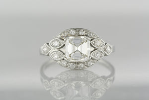 1.18 Carat GIA Certified Asscher Cut Diamond in an Early 1920s Art Deco Platinum Engagement Ring with Diamond Accents