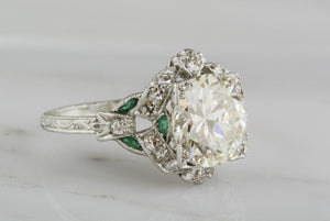 2.85 Carat Old European Cut Diamond (3.60 ctw) and Platinum Edwardian Engagement Ring; .50 ctw Single Cut Diamonds and .25 ctw Emeralds