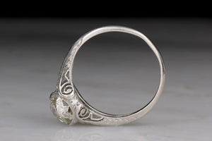 Late Edwardian Diamond and Platinum Engagement Ring with Scroll Filigree