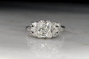Post Edwardian / Early Art Deco Platinum Ring with a 1.34 Carat Old Mine Cut Diamond Center