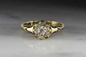 Antique British 1868 Victorian Rose-Yellow Gold and Diamond Engagement Ring with an Old Mine Cut Diamond Center