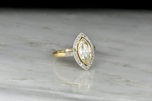 Belle Époque Gold and Platinum Ring with a Marquise Cut Diamond Center