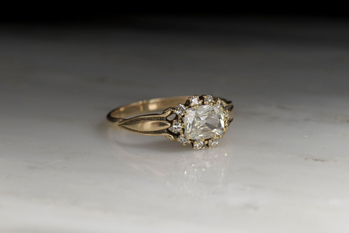 Victorian Gold Engagement Ring with a .73 Carat Rectangular Cushion Cut Diamond Center