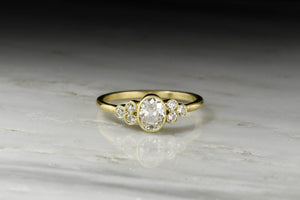 Oval Bezel Set Old Mine Cut Diamond Ring