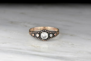 Low-Profile Victorian Three-Stone Diamond Ring: Transitional Cut Diamond Center